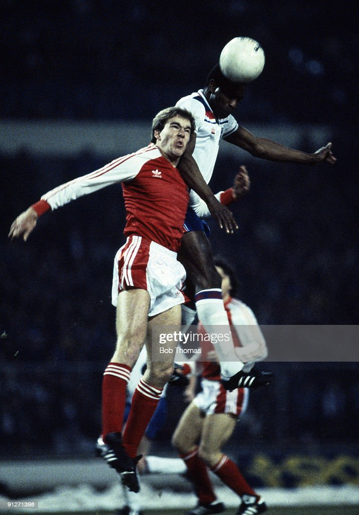 Luther Blissett of England heads the ball away from Kenny Jacket of Wales during the England v Wales British Championship match played at Wembley Stadium on the 23rd February 1983.