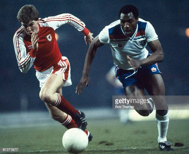 Luther Blissett of England moves past Kenny Jacket of Wales during the England v Wales British Championship match played at Wembley Stadium on the...
