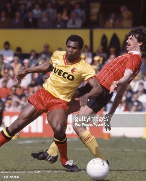 Luther Blissett of Watford evades a tackle from Mark Lawrenson of Liverpool during a Football League Division One match at Vicarage Road on May 14...