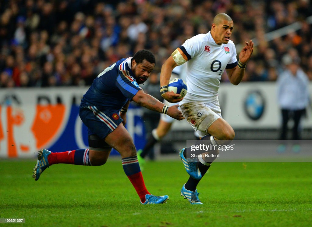 Luther Burrell of England break through to score a try during the RBS Six Nations match between France and England at Stade de France on February 1, 2014 in Paris, France.