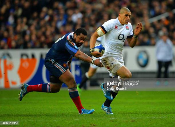 Luther Burrell of England break through to score a try during the RBS Six Nations match between France and England at Stade de France on February 1...