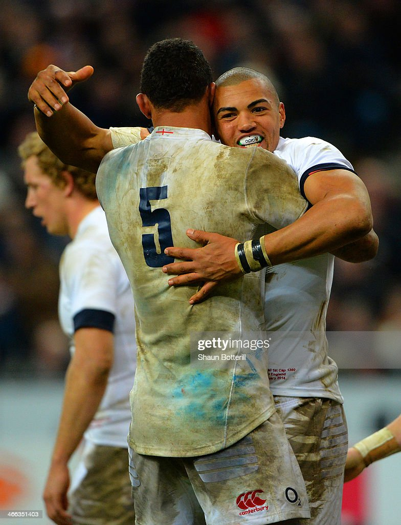 Luther Burrell of England celebrates his try with Courtney Lawes of England during the RBS Six Nations match between France and England at Stade de France on February 1, 2014 in Paris, France.