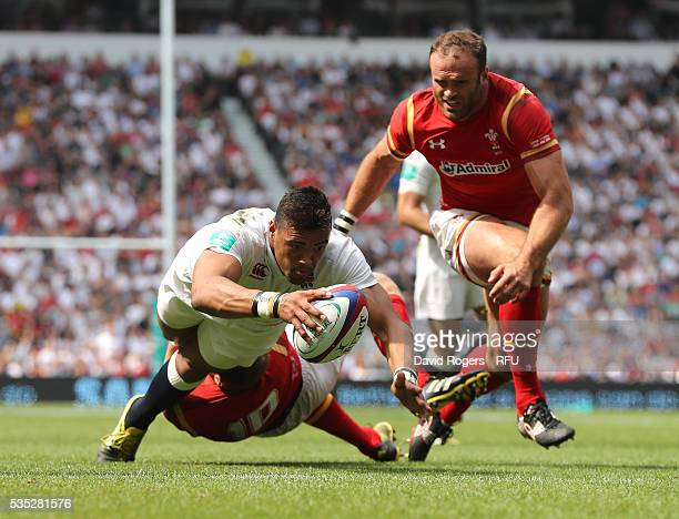 Luther Burrell of England dives over for their first try during the England v Wales International match at Twickenham Stadium on May 29 2016 in...