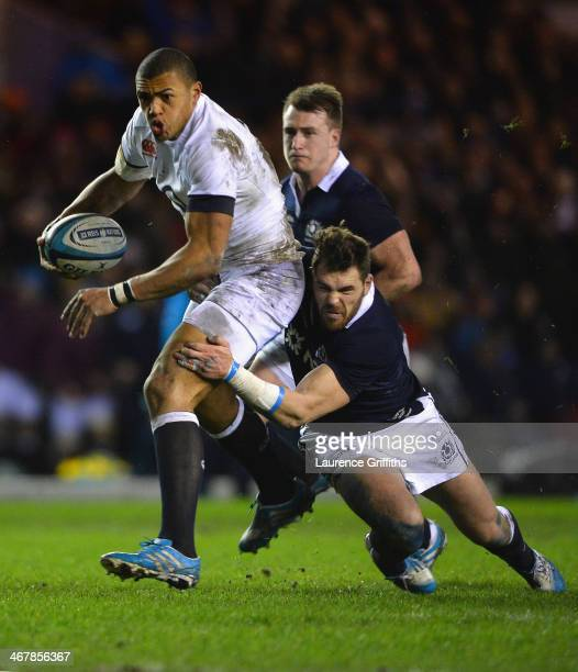 Luther Burrell of England is tackled by Sean Lamont of Scotland during the RBS Six Nations match between Scotland and England at Murrayfield Stadium...
