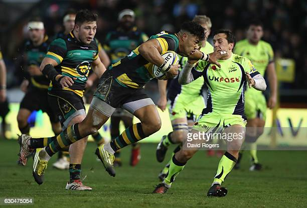Luther Burrell of Northampton breaks clear to score a last minute try during the Aviva Premiership match between Northampton Saints and Sale Sharks...
