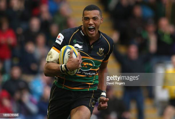 Luther Burrell of Northampton celebrates as he races clear to score a try during the Aviva Premiership match between Northampton Saints and Saracens...