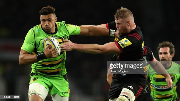 Luther Burrell of Northampton holds off George Merrick during the Aviva Premiership Big Game 10 match between Harlequins and Northampton Saints at...
