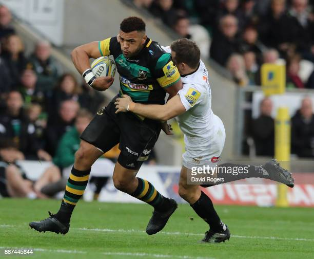 Luther Burrell of Northampton is tackled by Jimmy Gopperth during the Aviva Premiership match between Northampton Saints and Wasps at Franklin's...