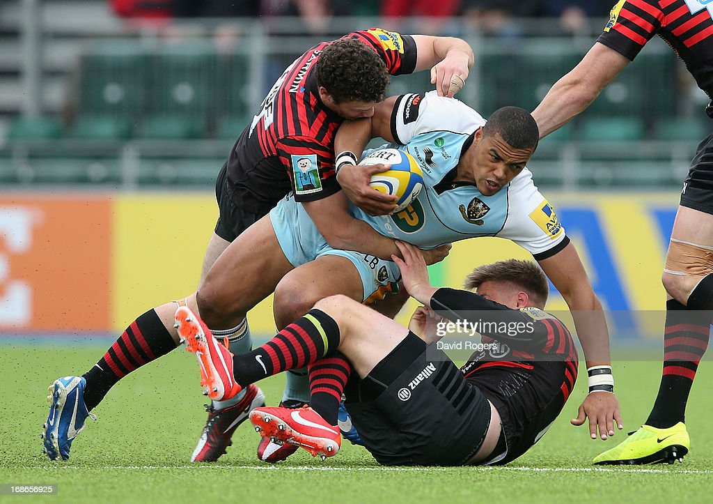 Luther Burrell of Northampton is tackled during the Aviva Premiership semi final match between Saracens and Northampton Saints at Allianz Park on May 12, 2013 in Barnet, England.