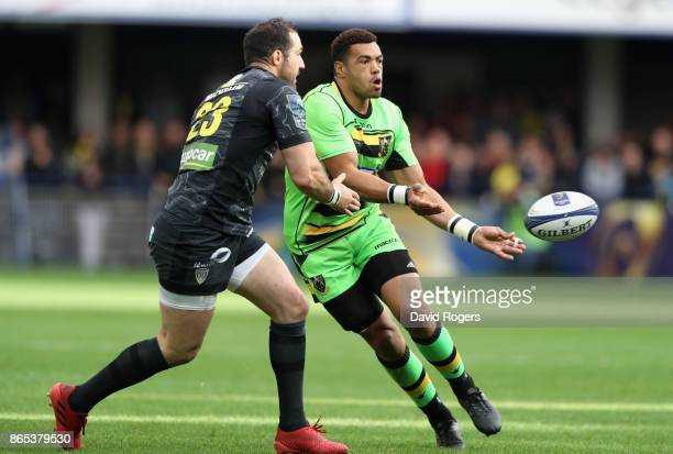 Luther Burrell of Northampton off loads the ball during the European Rugby Champions Cup match between ASM Clermont Auvergne and Northampton Saints...