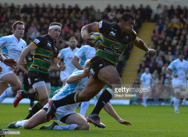 Luther Burrell of Northampton Saints breaks through to score during the Aviva Premiership match between Northampton Saints and Worcester Warriors at...