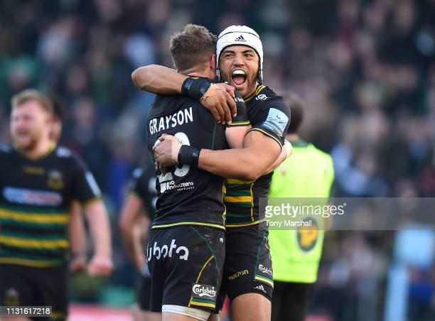 Luther Burrell of Northampton Saints celebrates with James Grayson of Northampton Saints after he kicked the winning points during the Gallagher...