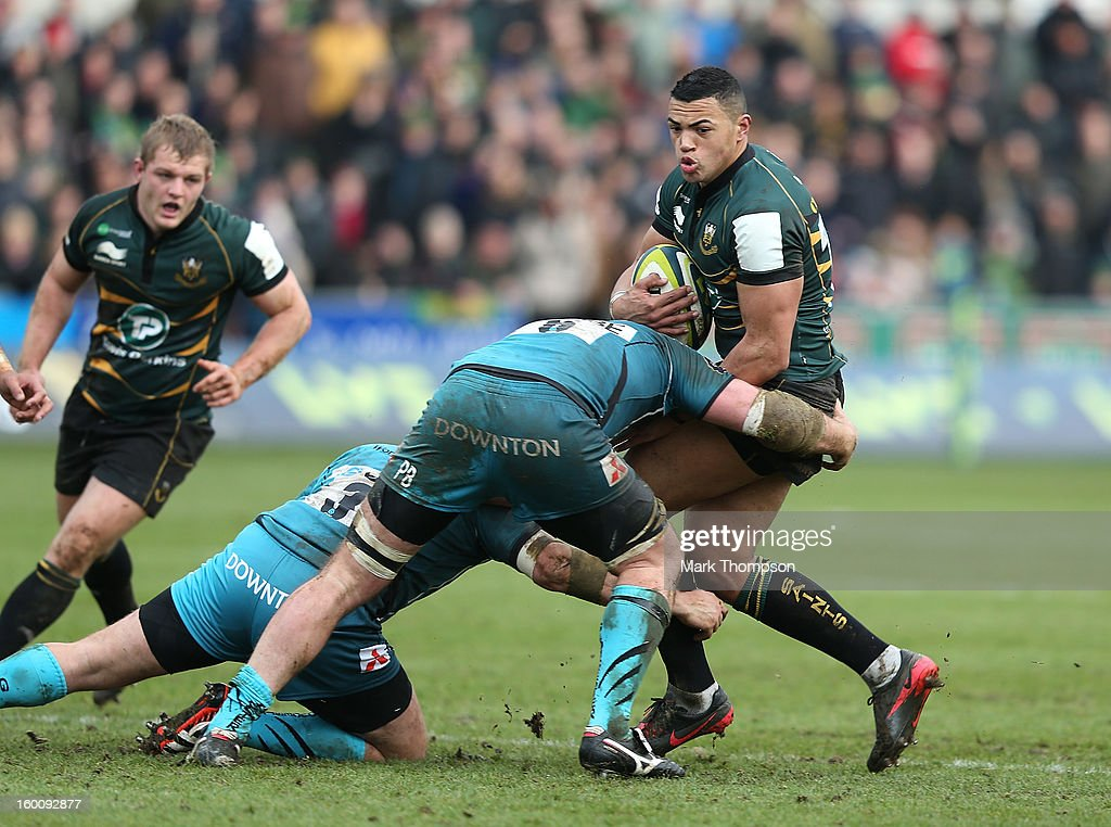 Luther Burrell of Northampton Saints is stopped by the Gloucester defence during the LV=Cup match between Northampton Saints and Gloucester at Franklin's Gardens on January 26, 2013 in Northampton, England.