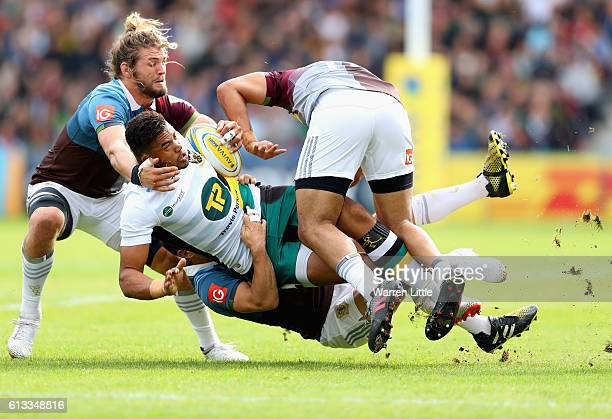 Luther Burrell of Northampton Saints is tackled during the Aviva Premiership match between Harlequins and Northampton Saints at Twickenham Stoop on...