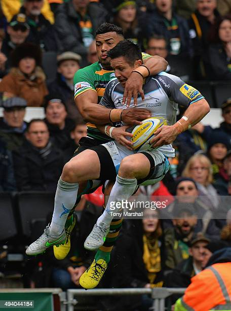 Luther Burrell of Northampton Saints tackles Mike Delany of Newcastle Falcons during the Aviva Premiership match between Northampton Saints and...