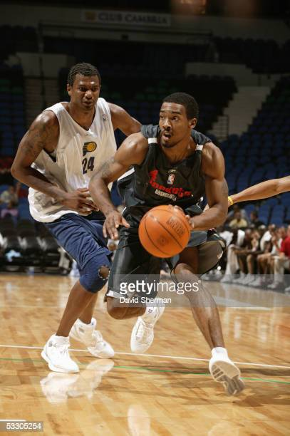 Luther Head of the Houston Rockets looks to drive past Jonathan Bender of the Indiana Pacers during the 2005 Minnesota Summer League on July 15 2005...