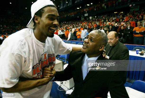 Luther Head of the Illinois Fighting Illini celebrates with assistant coach Wayne McClain after victory over the Arizona Wildcats in the Chicago...