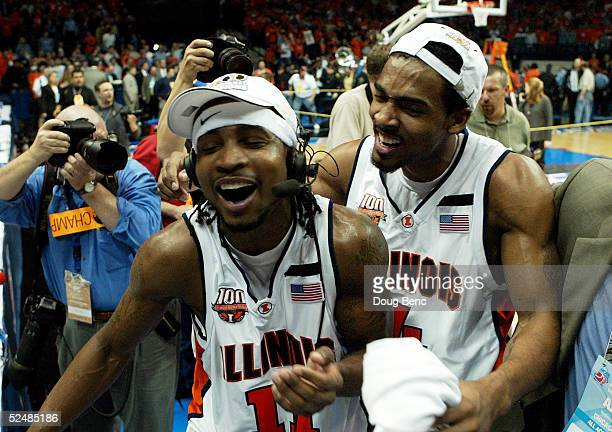 Luther Head of the Illinois Fighting Illini celebrates with teammate Dee Brown, L, as they celebrate victory over the Arizona Wildcats in the Chicago...
