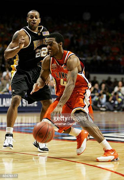 Luther Head of the Illinois Fighting Illini drives past Ed McCants of the WisconsinMilwaukee Panthers in game one of the Chicago Regional in the NCAA...