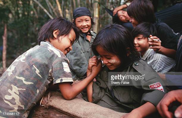 Luther Htoo plays with one of his soldiers in Kamerplaw southern Burma headquarters of God's Army He and his twin brother Johnny believed to possess...