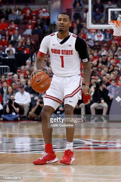 Luther Muhammad of the Ohio State Buckeyes brings the ball up the court in the game against the Maryland Terrapins at Value City Arena on February 23...