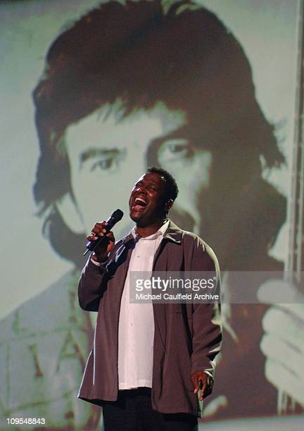 Luther Vandross salutes George Harrison among others in his memorial tribute performance during rehearsals for the 2002 American Music Awards at the...