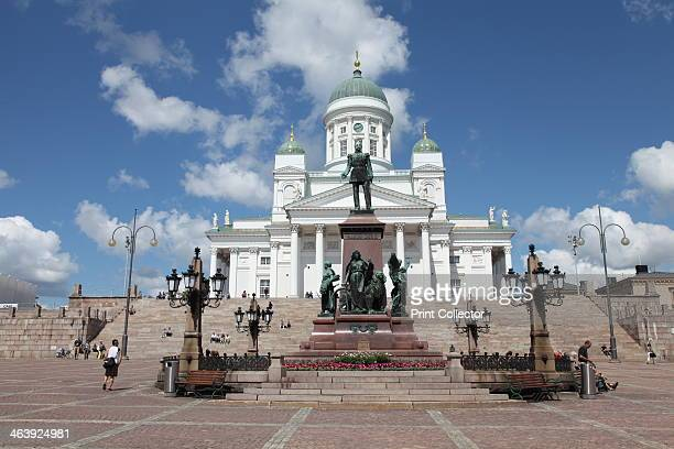 Lutheran Cathedral and the statue of Emperor Alexander II of Russia Helsinki Finland 2011 Helsinki Cathedral also known as the Cathedral of St...
