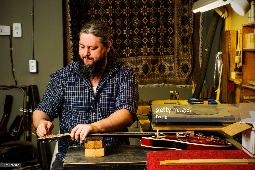 Luthier In His Guitar Repair Shop Stock Photo