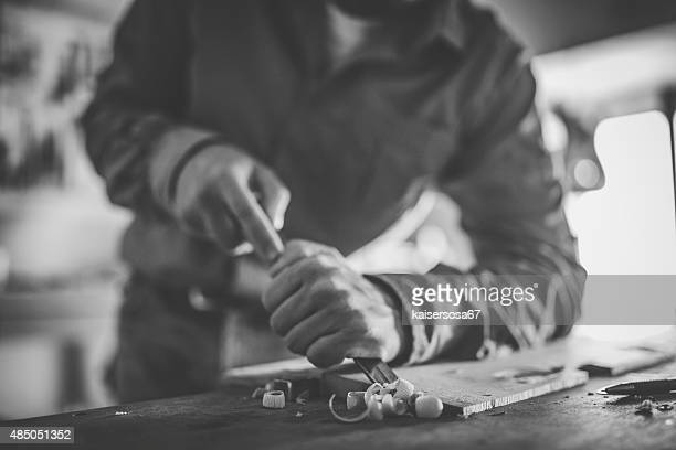 Luthier making a violin