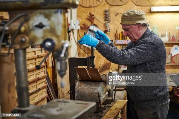 Luthier Roger Bucknall photographed at the Fylde Guitars workshop in Penrith, England, on December 12, 2019.