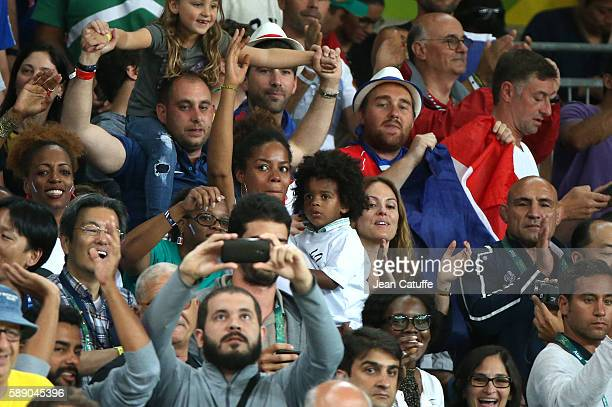 Luthna Plocus and Eden Riner son of Teddy Riner cheer for him during the Men 100kg Final on day 7 of the Rio Olympic Games at Carioca Arena 2 on...