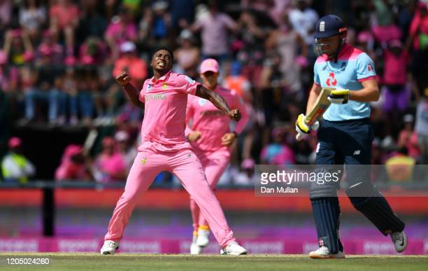 Lutho Sipamla of South Africa celebrates after taking the wicket of Jonny Bairstow of England during the 3rd One Day International match between...