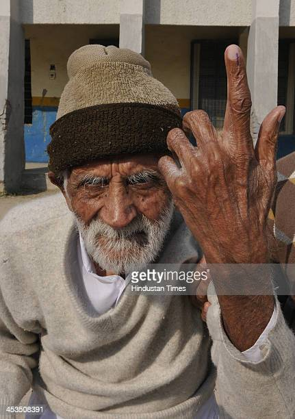 Luthra 90 year old man coming after casting his vote for Delhi Assembly elections at a polling station in East Delhi on December 4 2013 in New Delhi...
