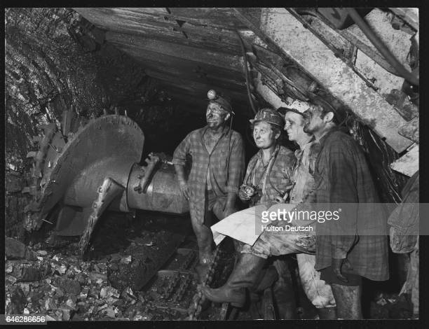 E Lutomski E Muciak J Kabus and A Banach the crew of the Longwall No 705 stand underground in the Pokoj Colliery