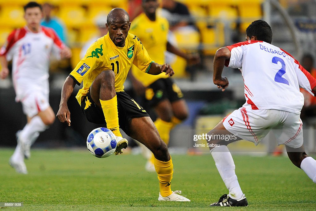 Luton Shelton #11 of Jamaica changes direction with the ball as Dario Delgado #2 of Costa Rica defends at Crew Stadium on July 7, 2009 in Columbus, Ohio.