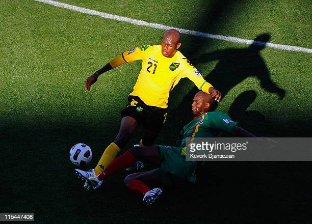 Luton Shelton of Jamaica is tackled by Leon Johnson of Grenada during CONCACAF Gold Cup qualifying match at The Home Depot Center on June 6 2011 in...