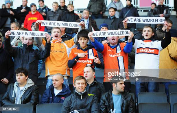 Luton Town fans show their support for AFC Wimbledon during the FA Cup with Budweiser Second Round match between MK Dons and AFC Wimbledon at...