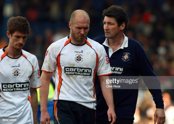 Luton Town manager Mick Harford consoles his dejected players after the CocaCola league two match between Luton Town and Chesterfield at Kenilworth...