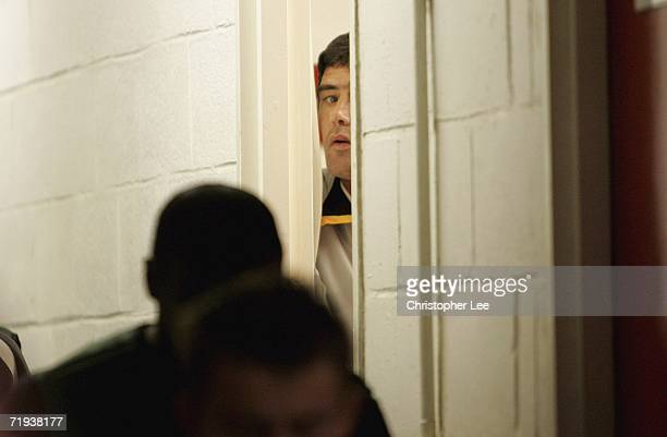 Luton Town manager Mike Newell looks out from the dressing room before kick off during the Carling Cup second round match between Brentford and Luton...