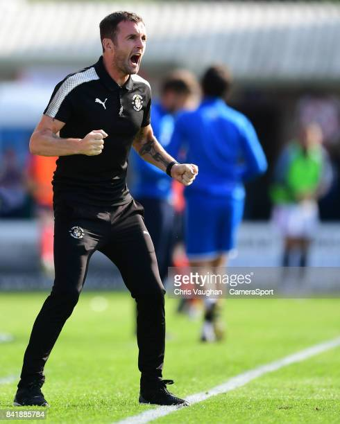 Luton Town manager Nathan Jones shouts instructions to his team from the technical area during the Sky Bet League Two match between Lincoln City and...