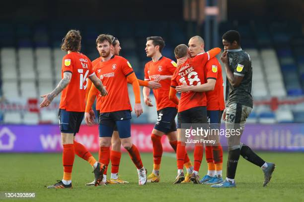 Luton Town players celebrate following their team's victory in the Sky Bet Championship match between Luton Town and Sheffield Wednesday at...