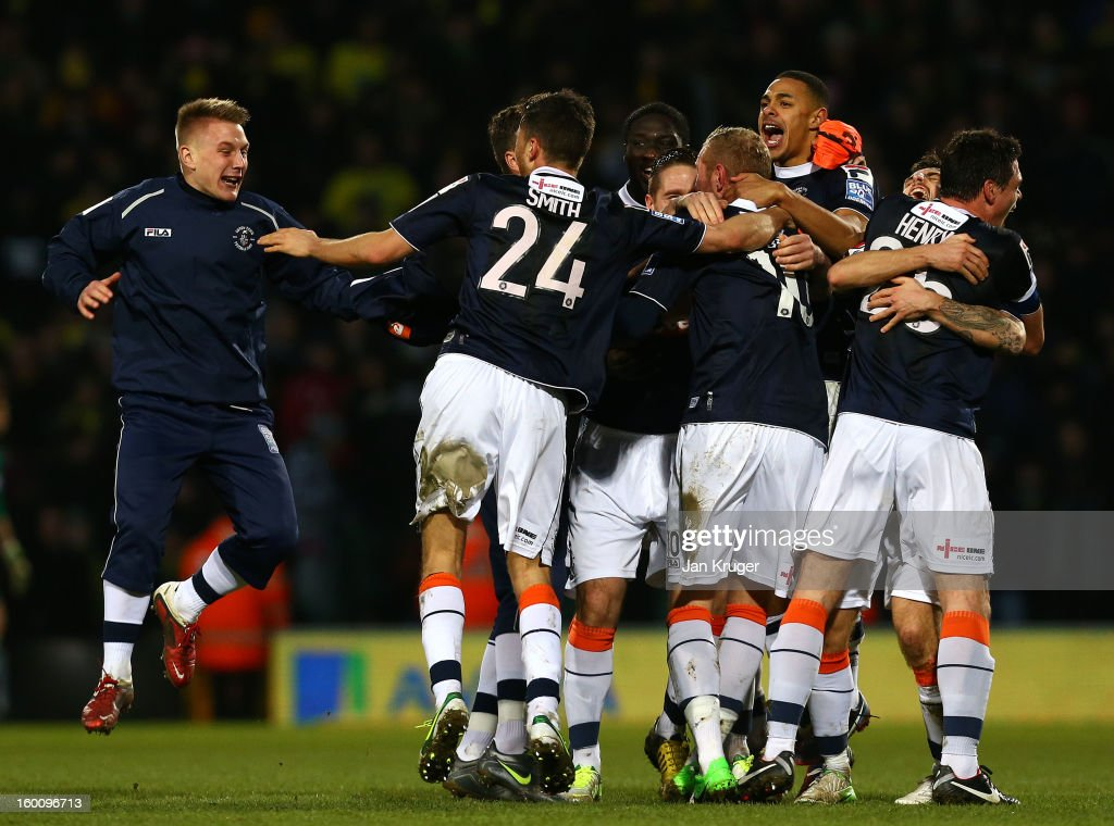 Luton Town players celebrate the win at the final whistle during the FA Cup with Budweiser fourth round match between Norwich City and Luton Town at Carrow Road on January 26, 2013 in Norwich, England.