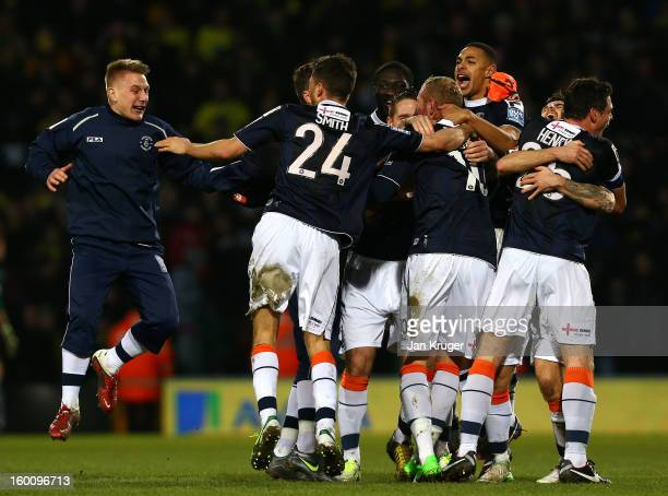 Luton Town players celebrate the win at the final whistle during the FA Cup with Budweiser fourth round match between Norwich City and Luton Town at...