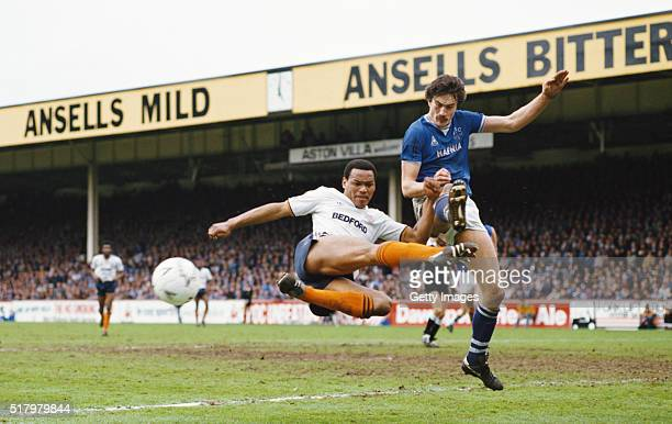 Luton Town striker Brian Stein is challenged by Everton defender Derek Mountfield during the FA Cup semifinal at Villa Park on April 13 1985 in...