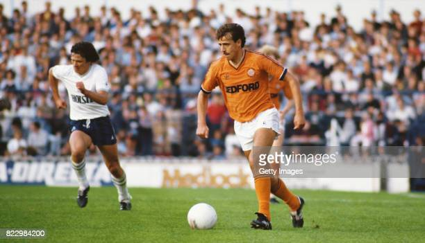 Luton Town winger David Moss in action as Steve Perryman looks on during a Canon League Division One match between Tottenham Hotspur and Luton Town...