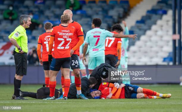 Luton Town's Dan Potts been treated for a head injury after a tackle on Swansea City's Conor Hourihane during the Sky Bet Championship match between...