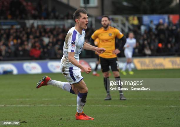 Luton Town's Dan Potts celebrates scoring his side's equalising goal to make the score 11 during the Sky Bet League Two match betweenNewport County...
