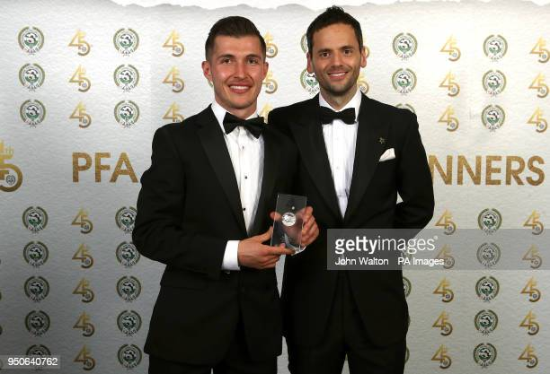 Luton Town's Dan Potts poses and PFA chairman Ben Purkiss with the PFA League Two Team of the Year award during the 2018 PFA Awards at the Grosvenor...