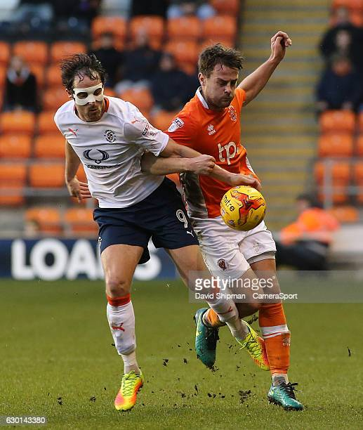 Luton Town's Danny Hylton battles with Blackpool's Andy Taylor during the Sky Bet League Two match between Blackpool and Luton Town at Bloomfield...