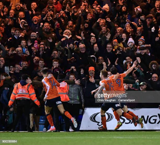Luton Town's Danny Hylton right` celebrates scoring his sides third goal during the Sky Bet League Two match between Luton Town and Lincoln City at...